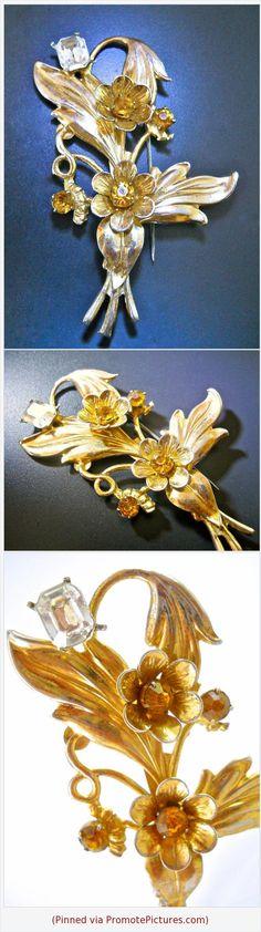 Sterling Silver Floral Brooch, Gold Wash, Citrine Rhinestones, Art Nouveau Vintage, 3 inch #brooch #sterlingsilver #flower #leaves #floral #goldwash #artnouveau #vintage #rhinestones https://www.etsy.com/RenaissanceFair/listing/583341841/sterling-silver-floral-brooch-gold-wash?ref=listings_manager_grid  (Pinned using https://PromotePictures.com)