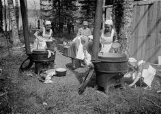 Finnish women of the Lotta Svärd voluntary auxiliary paramilitary organization prepare food for Finnish conscripts in a clearance camp shortly after the start of the Finnish-Soviet Continuation War. Kainuu, Finland. July 1941.