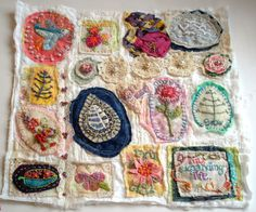 Every time I look at this I want to get my threads and fabric scraps out....just love it!  Beautiful little piece by fiberluscious:   My Sampler is Finally Finished!!