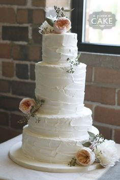 This is a beautiful rough butter cream cake with such lovely muted flowers.