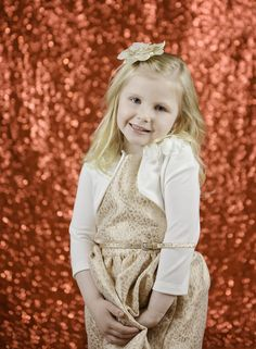 Add a little sparkle to your next photo shoot with our Red Sequin Fabric Backdrop! | Photo Courtesy of TriPod Photography