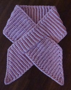 A ribbon scarf. This would be great in the breast cancer pink yarn. Great idea for donations
