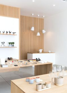 The light wood is a good match for the amount of natural lighting used in this retail design. Retail Interior, Cafe Interior, Interior Design, Store Interiors, Office Interiors, Commercial Design, Commercial Interiors, Retail Store Design, Spa Design