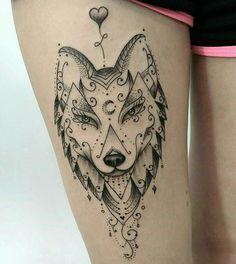 Fox face tattoo.
