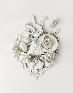 Buy My Hearts Content, a Found Objects on Paper by Anna Church from Canada. It portrays: Floral, relevant to: beauty, photography, sculpture, botanical, black and white , feminin, Sculptography, flowers, heart, fleur de lis A nod to the uncompromised beauty of 19th century plasterwork mouldings and an ode to a bygone area of extreme opulence. While it too could be seen as purely decorative, look closely and you will see that it is not cherubin, fleur de lis, and stylised foliage as might be…