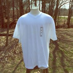 NWT Basic Edition White T-shirt NWT Basic Edition White T-shirt. Size 3X. 100% cotton. New with tag retail price nine dollars. V-neck. Basic Edition Tops Tees - Short Sleeve