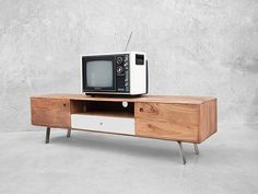 Kari is a media console with the lot. Beautiful finishes, closed and open storage and undeniable style.