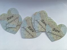Vintage map designed cut out hearts with personalized names and dates. I used these finishing details for baby shower invitations. Add these for personalized touches or as confetti for a special day.