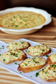 Artichoke Bruschetta – Cheesy artichoke dip is spread on baguette slices and broiled until golden and bubbly for an appetizer that's fancy yet no-fuss.