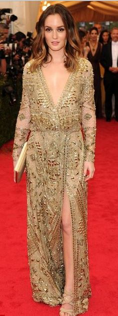 Who made  Leighton Meester's clutch handbag, jewelry, and gold long sleeve gown that she wore the 2014 Met Gala?