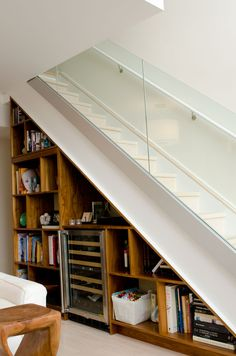 under stair storage space - Molly and John's Light-Filled Home for Five Staircase Storage, Stair Storage, Staircase Design, Book Storage, Storage Ideas, Apartment Design, Apartment Therapy, Attic Spaces, Craftsman Bungalows