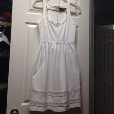 Weekend SALE! ⚡️White dress, lace cutouts @ bottom Adorable and flattering! And a great shade of white without being a harsh white!  I wore this white dress after my wedding. Very flattering. Gold zipper running down the back. Hidden pockets on sides. Only worn once!! Cynthia Rowley Dresses