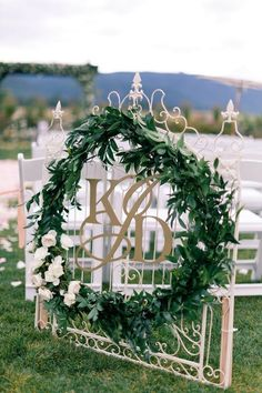 Love the gate,  initials, and foliage. I would like to see more foliage.