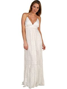 I've become too shy to wear a full plunging V line dress such as this, but I think I'm ready to try it again.  Once this stops being $365.00 ...