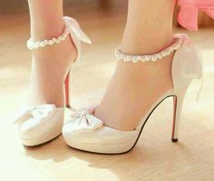 White heels with a bow.