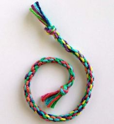 How to Make a Round Braid · Art Projects for Kids. If friendship bracelets are frustrating, try learning how to make a round braid. Group Art Projects, Art Projects For Teens, Yarn Projects, Art For Kids, Craft Activities For Kids, Crafts For Kids, Arts And Crafts, Craft Ideas, Kids Jewelry