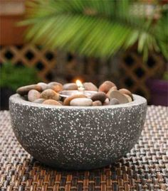 A unique alternative to traditional candle arrangements, the Rock Stone Fire Pot allows you to effortlessly accent your outdoor décor. Add a. Tiki Lights, Tabletop Fire Bowl, Candle Arrangements, Floral Arrangements, Fire Pots, Little Buddha, Coil Pots, Tiki Torches, Gardens