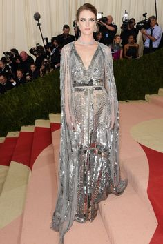 Mackenzie DavisYes, tonight's carpet is no stranger to some silver sequins, but Mackenzie Davis took it up a notch with a dramatic sheer cape by Altuzarra that added extra dimension to her skin-bearing, deep-V gown. An on-trend choker and stud earrings is all the look required to feel truly Met Gala-ready #refinery29 http://www.refinery29.com/2016/05/109782/best-dressed-met-gala-2016#slide-24