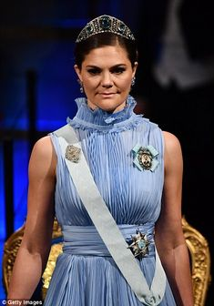 Crown Princess Victoria, 40, stunned in a sweeping powder blue number...