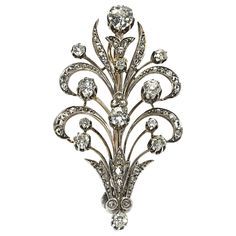 Diamond Silver Gold Flower Brooch    From a unique collection of vintage brooches at https://www.1stdibs.com/jewelry/brooches/brooches/