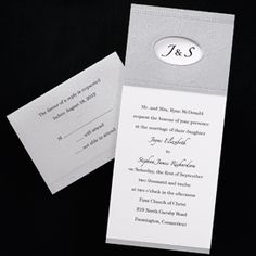 White Invitation with Silver Shimmer Wrap  Your white non-folding invitation tucks inside a silver shimmer wrap, which features a cut-out window at the top to reveal your initials. An embossed design accents the window. Silver enclosures; white envelopes. We recommend black ink for enclosure cards.