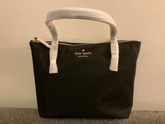 This is a brand new tote from Kate Spade New York. The color is black. Grab it before it's gone.   Quick shipping and handling for the holidays. Kate Spade Totes, Kate Spade Tote Bag, Nylon Tote, Madewell, Brand New, Tote Bags, Black, Color, York