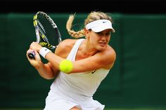 Eugenie Bouchard of Canada plays a backhand return during the Ladies' Singles final match against Petra Kvitova of Czech Republic on day twelve of the Wimbledon Lawn Tennis Championships at the All England Lawn Tennis and Croquet Club on July 5, 2014 in London, England. (Photo by Al Bello/Getty Images)
