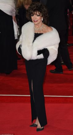 Monochrome Madam!Dame Joan Collins looked as glamorous as always in an off shoulder black dress teamed with a white shawl