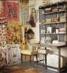 Love the scarf curtain in this craft room