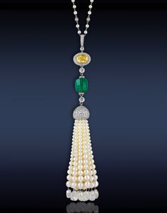 Tassel Necklace, Composed CD Certified 8.45 Ct Green Emerald, Surmounted by GIA Certified 3.04 Ct VVS2, Fancy Vivid Yellow Oval Shape Diamond, and 56.90 Ct Pearls Hanging on the Tassel, Highlighted with 17.05 Ct Briolette and round Brilliant Cut Diamonds Mounted in Platinum.