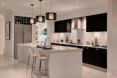 Black and white kitchen ideas... backsplash and wine rack above fridge.