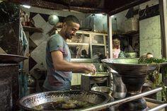 working in a Falafel  restaurant  in a street area Darb El Ahmar