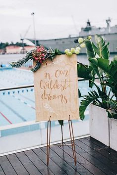 wedding signage with tropical flowers