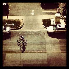 @Demotix A cyclist passes by, downtown Austin. @Brian McGloin