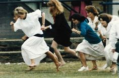 June 28, 1989:  Diana, Princess of Wales(white dress, left) storms away from the field at the start of the mothers race, held during a sports day for Wetherby school, where her son Prince William is a pupil. The race was held at the Richmond Rugby Club, in Surrey, just south of London. Diana, who led all they way, was just beaten on the finish line into second place.