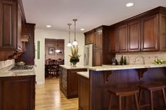 Dark wood kitchen cabinets.