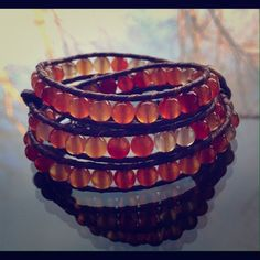 """Red carnelian triple wrap bracelet Triple wrap bracelet with real red carnelian. Made with vegan leather! Carnelian is known for its bold energy bringing a rush of warmth and joy that lingers, stimulates and empowers! Known as the stone of motivation and endurance, leadership and courage. Give a gift of meaning!  Has 2"""" of extension to adjust size! eves eye candy Jewelry Bracelets"""