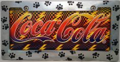 "1 , Drink Metal Sign, "" ,COCA-COLA, with, LIGHTING BOLTS, "", Metal Sign, Enclosed by a, Chrome Metal Holder, with, Black, Paw Prints,,,6A3.3&29B3.0,,,SHIPPED USPS,,,, ASTRODEALS,http://www.amazon.com/dp/B00I21SGVO/ref=cm_sw_r_pi_dp_xEy.sb1NWGGVDWMR"