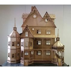 The Ashley 1:12 scale Gothic Victorian dollhouse measures 48W x 24D x 50H (inches). It has detailed porch framing, Victorian gingerbread , detailed railings, window frames, Plexiglas window inserts, and more. The interior has dividers around the stairs that you may choose to leave out to extend the room on the left or right. Pictures of the interior show the dividers installed on the first three floors. The main doors have two frames to simulate a storm (screen) door and main door.