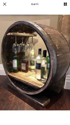 A whisky barrel bar made from a retired Glenmorangie Single Malt Scotch Whisky barrel. The internal LED light illuminates the contents of the bar and showcases the rustic toasted barrel staves. A wonderful innovative piece.