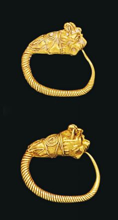 A PAIR OF GREEK GOLD SPIRAL LION-HEAD EARRINGS   HELLENISTIC PERIOD, CIRCA LATE 4TH CENTURY B.C.-3RD CENTURY B.C.   Each with twisted tapering hoop, terminating in a lion's head emerging from a collar decorated with loop and scroll filigree; and another similar pair with loop emerging from lion's mouth  ¾ in. (1.8 cm.) diam. max.