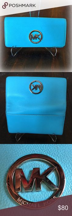 Michael Kors Fulton Carryall Wallet Michael Kors Fulton carryall wallet in teal with silver hardware! 14 cc slots, a zippered coin slot in the center. Two additional bill slots inside and one on the outside!  Nice leather and snap closure! Hardware has a few scratches otherwise in great condition! Michael Kors Bags Wallets
