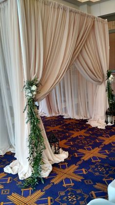 Champagne Chiffon adorned with Floral and greenery creates a beautiful backdrop or canopy for your ceremony.  #920events #weddingceremony #920eventsdecor #wisconsinwedding