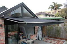retractable awning , this is a non cassette type, love the fact that the awning matches house trim, looks great