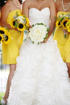 I don't normally like sunflowers in wedding bouquets, but there's something about this combo with the yellow dresses that I love so much.