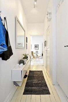 Planète Deco - Small hallway, but there's room for storage - I guess it's Ikea CD storage White Hallway, Entry Hallway, Hallway Ideas, Corridor Ideas, Ikea Cd Storage, Hallway Storage, Shoe Storage, Small Hallways, House Entrance