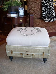 this delightful piece was found at The Pauper's Castle blog.  I bought the old suitcase, now I just have to get busy making the ottoman.  Love it!  It will be perfect for the family room makeover