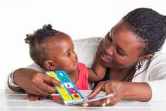African Mom Reading To Baby photos, royalty-free images, graphics, vectors & videos Baby Development In Womb, What Is Ptsd, Relationship Bases, Relationships, Mother Pictures, Mindful Parenting, Holding Baby, Reading Time, Skin So Soft