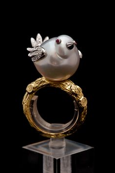 Baroque south sea pearl shaped into a ruby-eyed, diamond-winged birdie