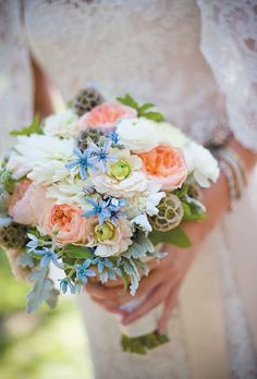 A bouquet with a combination of Juliet garden roses, dusty millers, scabiosas, mint, and tweedia | Brides.com